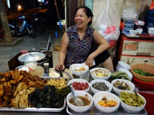 Happy-food-vendor,-Hanoi,-Vietnam-000059001238_Double
